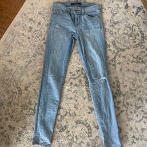 J Brand light wash distressed skinny jeans